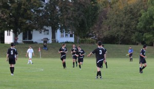 Gabe Smith (#8) after scoring a goal for Bowdoin late in the first half