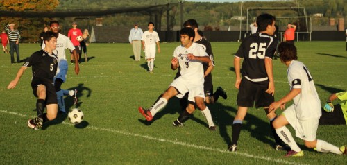 Cameron deWet (#5) slides across to block the open-net shot of Nico Faiafas