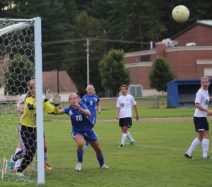 Kendall Dolan looks for a rebound on a direct kick that hit the post.