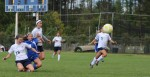 Lexi L Heureux-Carland clears away a Kennebunk threat