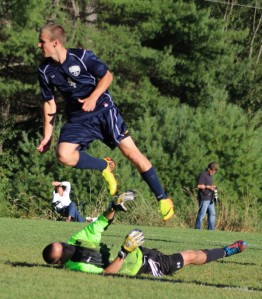 Mike Gallagher (2 goals) sails over LR goalie as he scores the 10th York goal