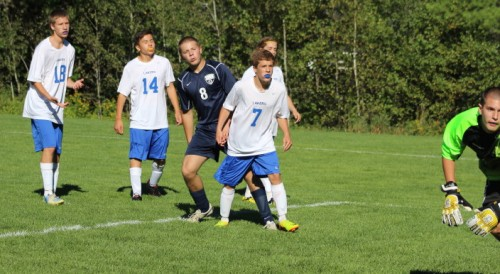Josh Mitchell (8) watches the first of his four goals go past Lake Region goalie Mike Rust