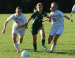 Emily Brengle and Sydney Law try to contain Bridgett Kiernan