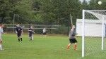 Colin Macomber watches a kick sail over the net