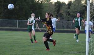 Isobel Scribner reaches for a Laker save