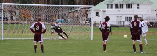 Freeport goalie Brendan Qualls guesses left and Gabe Perry shoots the penalty kick right.