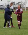 FA coach Bob Hodgman-Burns congratulates Brendan Qualls after the game