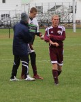 FA coach Bob Hodgman-Burns congratulates Brendan Qualls after the game