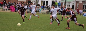 Forrest Stearns (14) chases a loose ball