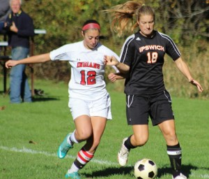 Amanda Martin (12) and Katie Monahan (18) battle