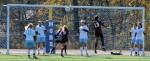 Anna-Maria Dagher (9) heads the ball over the net