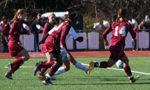 Jenna Soucy, in the midst of four Rams, fires the third goal