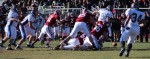 Bobby Drysdale (9) fumbles after hit by Alec Byrnes (66)