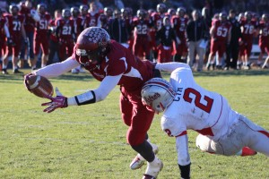 Seimou Smith lunges into the end zone after catching a pass from QB Rob Law late in the second quarter