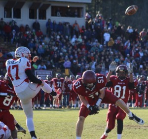 Will Scharlotte deflects the punt of Kyle Cantalupo.
