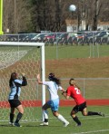 Windham GK Kate Kneeland, Ariana Davidson (11), and Katherine Kirk (21) in front of the Windham net