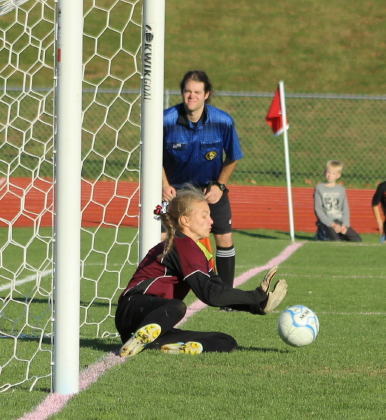Liz Mycock blocks the penalty kick of Sam Sparda.