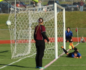Liz Mycock watches the shot of Lauren Shoemaker go in the net to win the game for Windham
