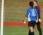 Liz Mycock chats with Sydney Martin before the penalty kicks begin