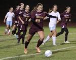 Katie Senechal dribbles ahead