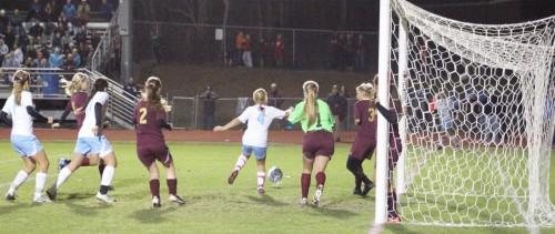 Emily Gorrivan (4) receives corner kick from Ciera Berthiaume