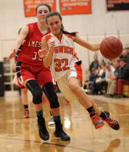 Freshman Kelsey Daly drives past Abigail Sartori
