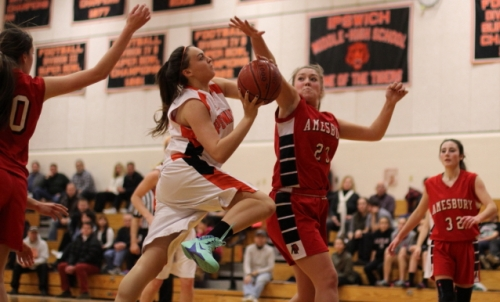 McKenzie Cloutier (23) tries to stop driving Abby McCarthy
