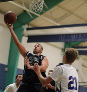 Kyle Lentini (13 points) gets a layup