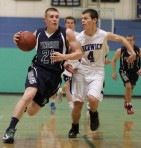 Griffin Beal (21) drives on Mark Hoyt (4)