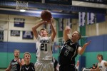 Erik Fyrer (5) blocks the shot of Luc Linemayr (21)