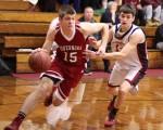 Patrick Davis (15) heads for the hoop with Ben Cherington (13) in pursuit
