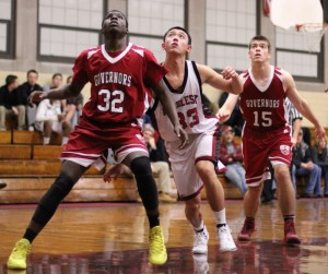 Michael Osarenren (32), Jon Siu (33), and Patrick Davis (15) look for a rebound