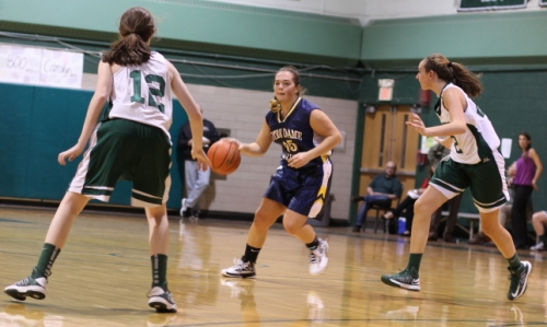 Kendra Delahunt (12 points) looks for an opening between Kelsi McNamara and Riley Holden