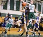 McKenna Kilian (23) goes for the block