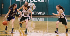 A trio of Pentucket defenders chase Janey Mathisen