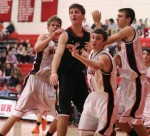 Pat Racy (12 points) draws heavy coverage