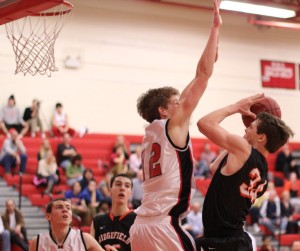 Ryan Fitzpatrick goes for the block on Charlie Irwin (12 points)