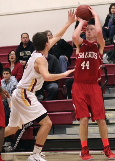 Joe Bertrand (32 points) shoots a three over Drew Bourdeau