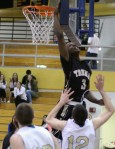 Tramere Adams (11 points) tries for a block