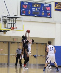 Jaqhawn Walters blocks the shot of Eric Houska