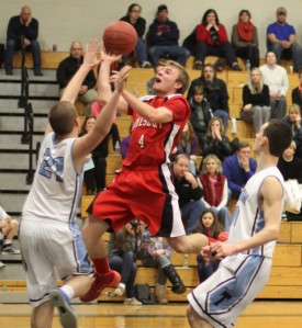 Pat Halloran (14 points) floats in the lane