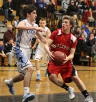 Ryan Foley (10 points) drives on Kevin Clark