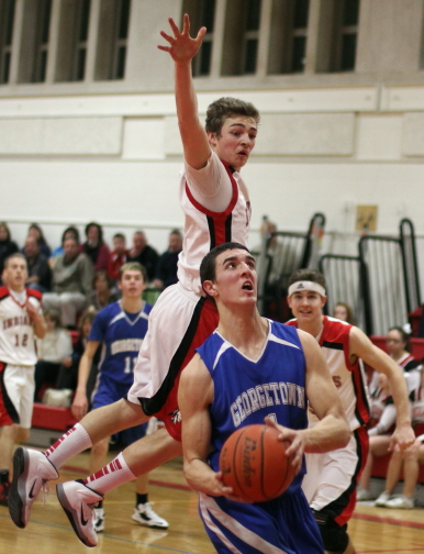 Pat Bjork (19 points) avoids leaping Ryan Foley