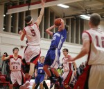Ben Noelk (12 points) tries to shoot over Pat Scanlon