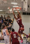 Johnny Hilaire (15 points) finishes a dunk