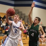 Jack Freed goes for a block against Cam Armand