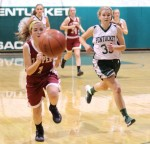 Aly Leahy and Rebecca Torrisi chase a loose ball