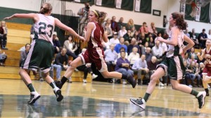 Aly Leahy (12 points) heads for the basket as McKenna Kilian defends