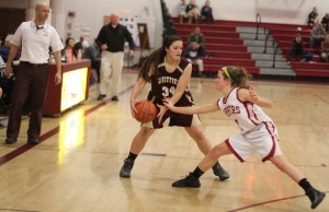 Aly Leahy (13 points) tries to steal from Dominque Ortiz as NHS coach Gregg Dollas watches