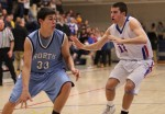 Daniel McCoy (33) drives on Matthew MacLeod (12)